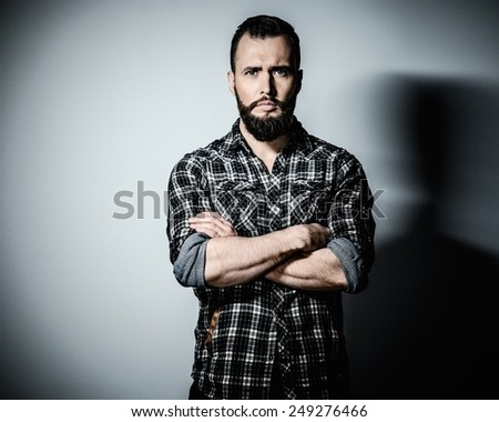 Handsome man with beard wearing checkered shirt