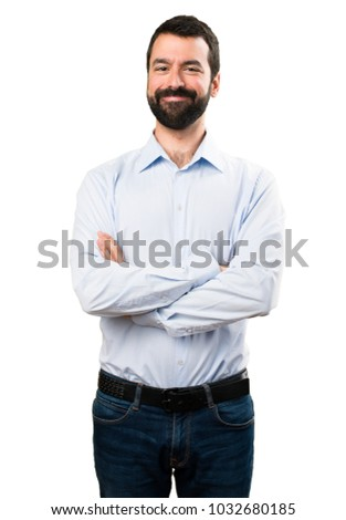 Handsome man with beard with his arms crossed