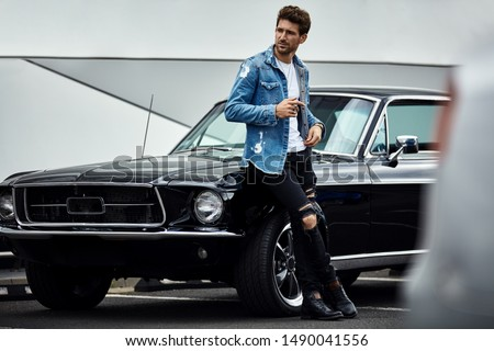 Handsome man with black classic car wear smart casual  #1490041556