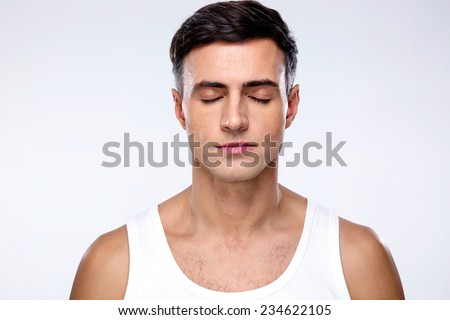 Handsome man with closed eyes over gray background #234622105