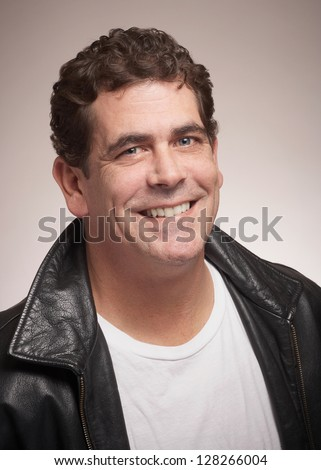 Handsome man with friendly smile in black leather jacket