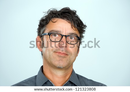 handsome man with glasses is looking friendly
