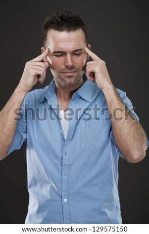 Handsome man with headache #129575150