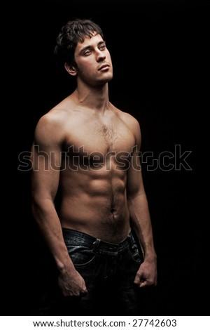 Handsome Man With Naked Torso Against Black Background Stock