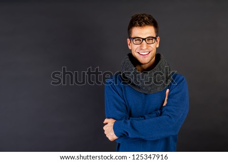 Handsome man with scarf and smile on black background