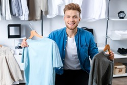 Handsome man with stylish clothes in dressing room