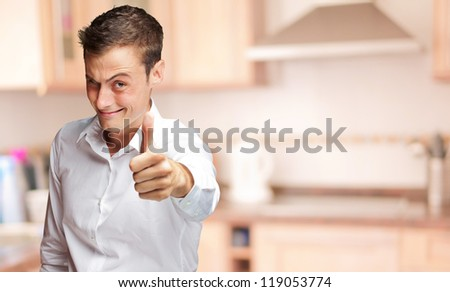 Handsome Man With Thumbs Up Sign And Winking, Indoor