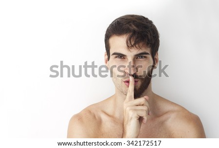Handsome man without a shirt standing in front of a camera with half of his face with scruffy beard and messy hair, the other half has a beautiful trimmed beards and smart look hair style.