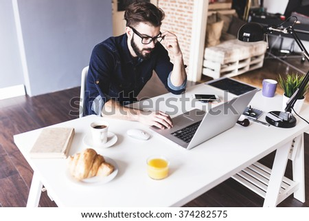Handsome man working from his home office