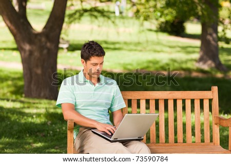 Handsome man working on his laptop
