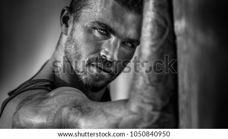 Handsome mans portrait in black and white #1050840950