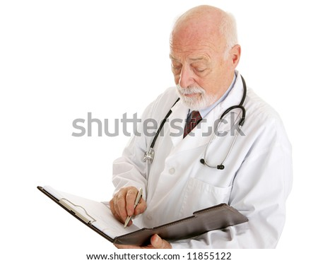 Handsome mature doctor making notations in a patients chart.  Isolated on white.