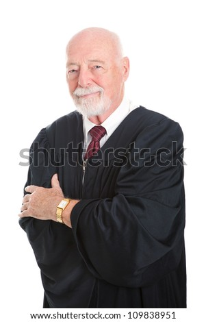 Handsome mature judge in his judicial robes, with his arms crossed.  Isolated on white.