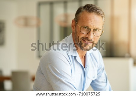 Handsome mature man with eyeglasses looking at camera