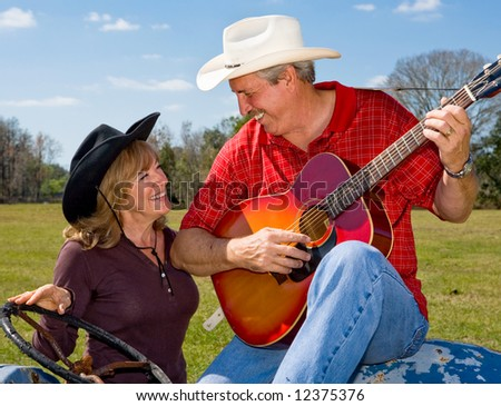 Handsome mature singing cowboy flirting with his beautiful wife.