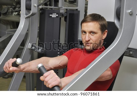 Handsome men exercising in the gym
