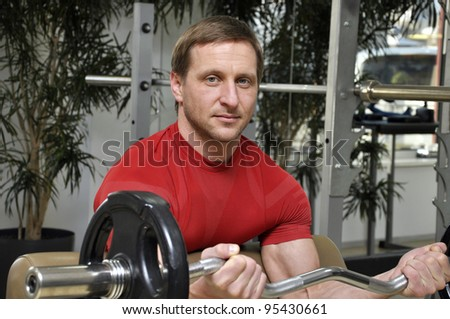 handsome men  lifting weights in the gym