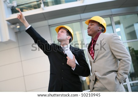 Handsome men working as architects on a construction site