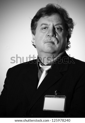 Handsome middle age business man wearing a suit, black and white