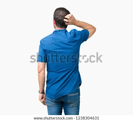 Handsome middle age elegant senior man over isolated background Backwards thinking about doubt with hand on head