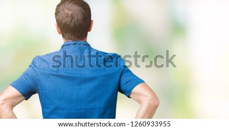 Handsome middle age elegant senior man over isolated background standing backwards looking away with arms on body