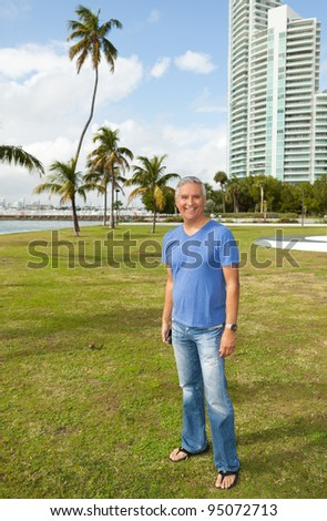 Handsome middle age man enjoying a popular South Beach park in Miami. - stock photo
