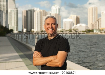 Handsome middle age man in an outdoor urban setting with Miami Biscayne Bay in the background.