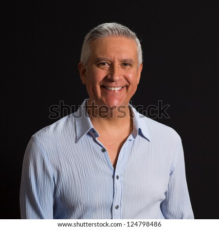 Handsome middle age man on a black background.