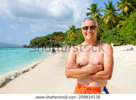 Handsome middle age man on a Caribbean beach in Saint John.