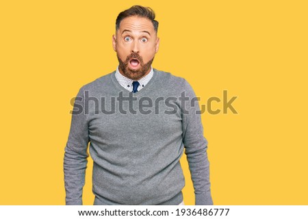 Handsome middle age man wearing business clothes afraid and shocked with surprise and amazed expression, fear and excited face.  Сток-фото ©
