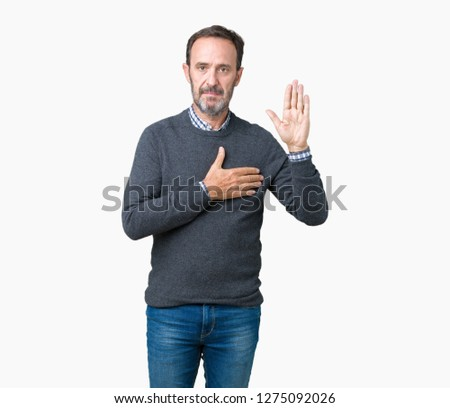 Handsome middle age senior man wearing a sweater over isolated background Swearing with hand on chest and open palm, making a loyalty promise oath #1275092026