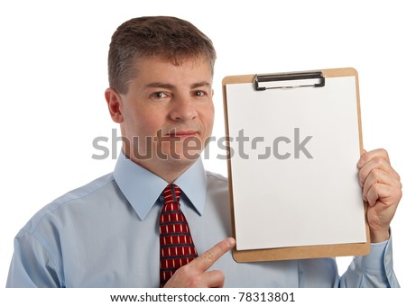 Handsome middle age successful businessman points to clip board - with clip board clipping path - stock photo