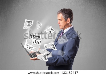 Handsome middle aged businessman holding notebook and reading the explosive newspaper