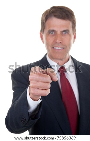 Handsome middle aged businessman pointing his finger and smiling - selective focus on the finger.