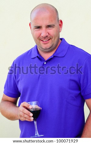 Handsome Middle aged man drinking red wine