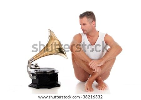 Antes fossem os meus audiófilos... Stock-photo-handsome-middle-aged-man-in-his-forties-with-antique-record-player-studio-white-background-38216332