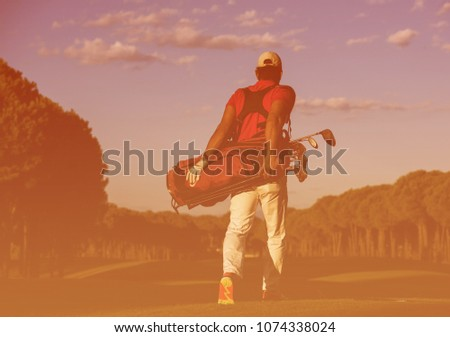 handsome middle eastern golfer  carrying  golf bag  and walking at course to next hole #1074338024