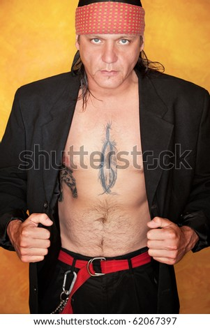 stock photo : Handsome mixed race man with feather tattoo