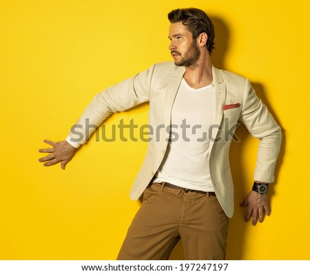 Handsome model on yellow background