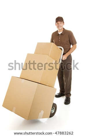 Handsome moving man or courier delivering a stack of boxes.  Isolated on white. - stock photo