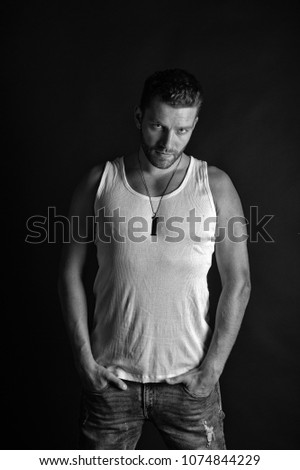 Shutterstock Handsome mucho guy in vest. Fashion and beauty. Fashion model on grey background. Man with unshaven face in studio. Style and look, barber, black and white