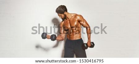 Handsome Muscular Men, Bodybuilder Lifting Weights. copy space