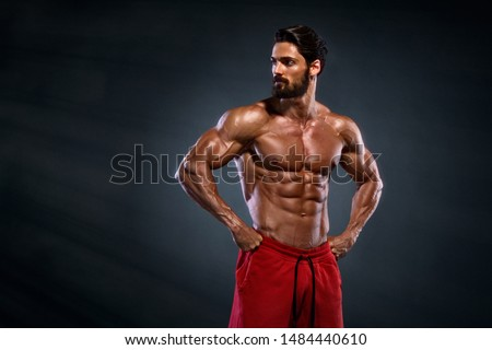 Handsome Muscular Men Posing and Flexing Muscles