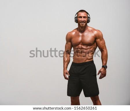 Handsome Muscular Men Wearing Headphones