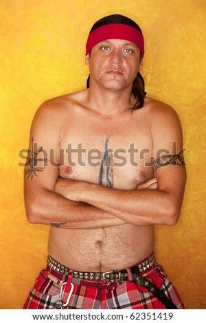 Handsome Native American man with tattoos and plaid pants