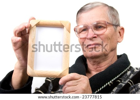 Handsome old man holding empty wooden frame