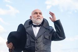 Handsome oldfashion senior old mature man. Elderly mature greybeard. Vintage man in suit