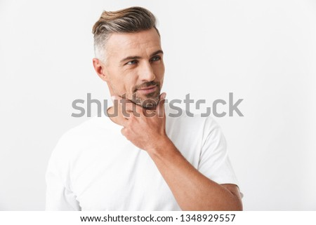 Handsome pensive casual man standing isolated over white background, thinking