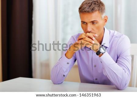 Handsome pensive man - stock photo