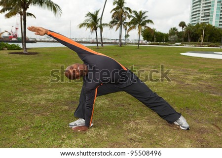 Handsome personal trainer exercising in a popular South Beach park in Miami. - stock photo